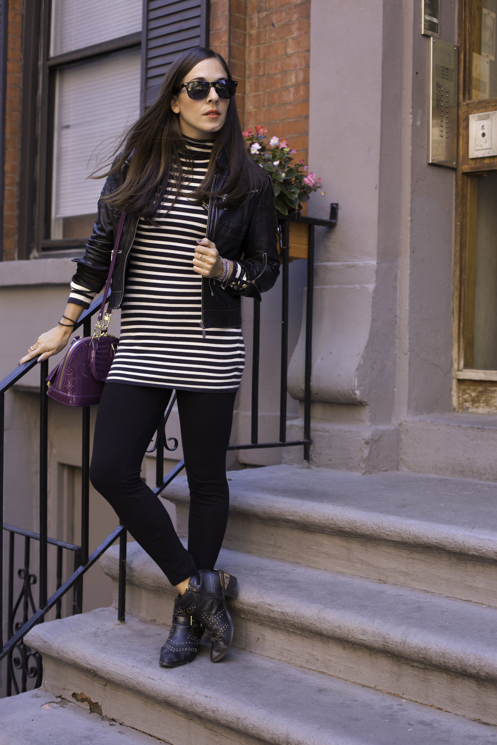 Wearing black leggings with my  Aldo  booties,  H&M  bodycon striped dress and  Bebe  leather biker jacket.  Louis Vuitton  mini cross body Alma bag. Photography by  Francisco Graciano .