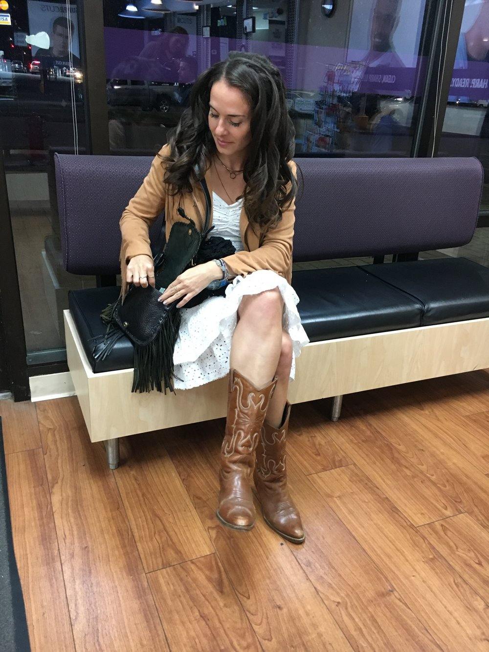 "Post blowout appointment getting ready for the festivities in my  12th Tribe  ""ferris fringe jacket"" cowboy boots and white eyelet dress with RM fringe purse."