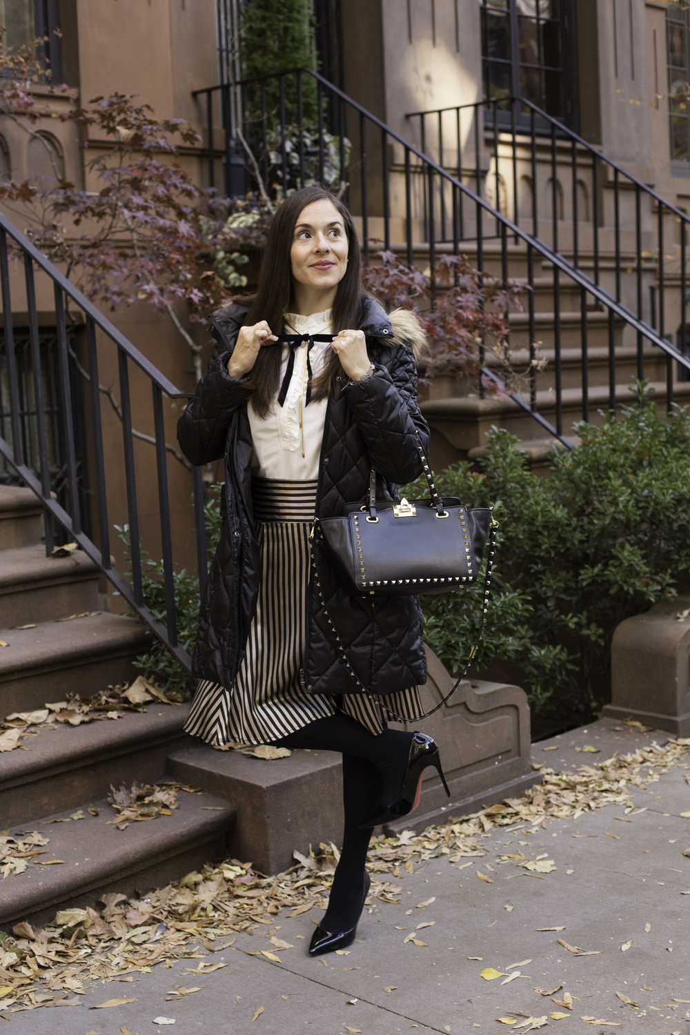 In my JCrew sleeveless ruffled collar top with Free People gold chain and attached velvet black bow, vintage striped skirt, black tights and Christian Louboutin pumps, Valentino Rock Stud bag and Guess coat. Photography by Francisco Graciano.