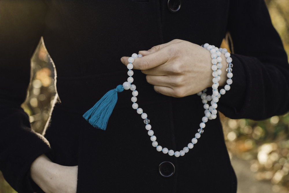 Wearing the aquamarine mala bead necklace with crystal. Photography by  Francisco Graciano .
