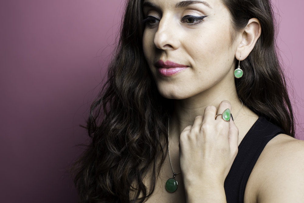 Wearing Made in Earth Collection Jadeite Drop Earrings, ring, and pendant. More details below on the healing properties of this stone.