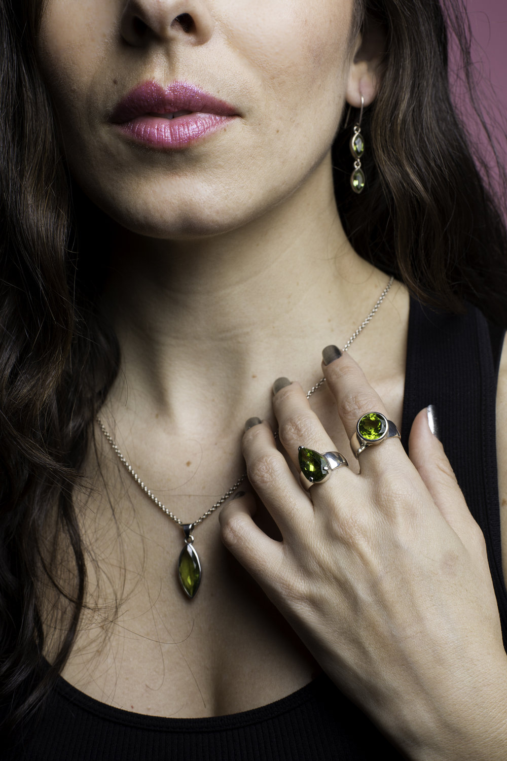 Wearing Made in  Earth Collection Peridot Drop Earrings, pendant, and rings. More on the stone's energetic properties below. All photography by Francisco Graciano.