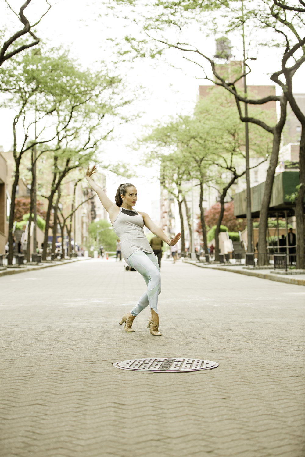 Dancing on the NYC streets in my Puma leggings and tank! All current Puma items. Photography by Francisco Graciano.