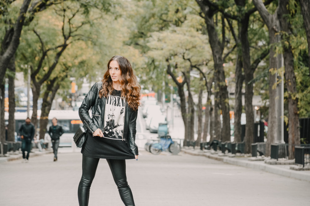 Running around the city in Tasch NYC band tee, Bebe leather moto jacket, Blank NYC vegan leather leggings, H&M ankle booties and YSL medium Kate black purse. Photography by  Meghan Asselta .
