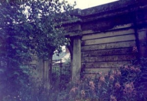The magnificent Greek revival archway at the entrance to the cemetery, now obscured by foliage during the summer months