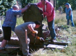 Christian and Jewish volunteers working to re-erect a fallen gravestone during the first working party, 8 June 2006