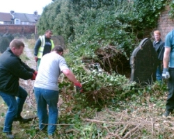Probation Service workers dragging huge tracts of severed ivy away from the boundary wall, 20 September 2006