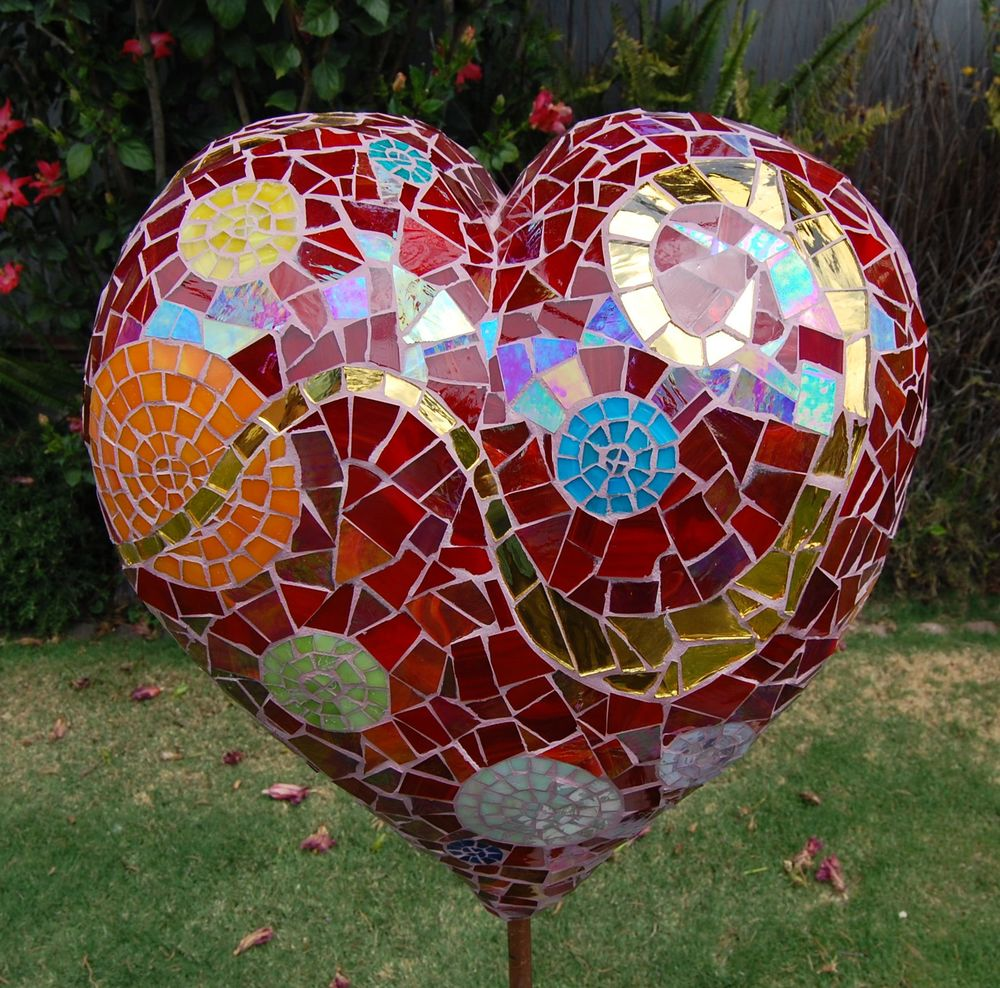 Heart of the garden.       2010   Light weight concrete sculpture, stained glass and gold mirror.
