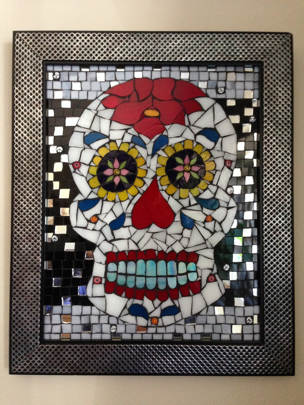 Dia de los Muertos.  2012  Acrylic mold skull with stained glass, mirror, millefiori, Italian smalti, metal spikes and rhinestones.