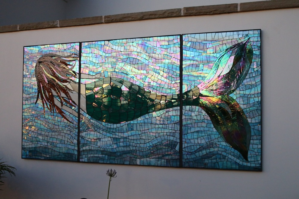 The Mermaid, 7x 3 1/2 feet. Stained Glass, gold smalti and beads. Created on Wedi Board, mounted on Hardie Backer board for stability and framed in custom made stainless steel frames. At a private residence in Snata Barbara, CA. 2015.