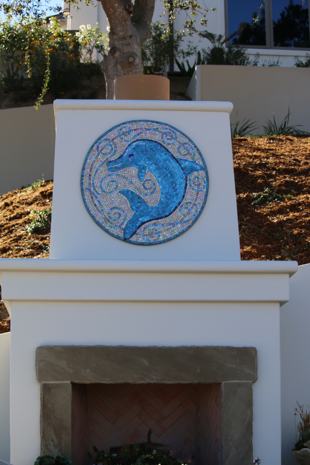 "Dolphin.  Mexican smalti, gold smalti and glass fusion.  36"" diameter with epoxy grout."