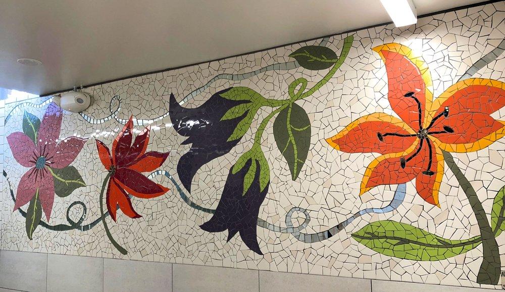 """Community Arts Workshop"" Ladies restroom . 12'x4', materials are Ceramic tile, mirror, cement grout."