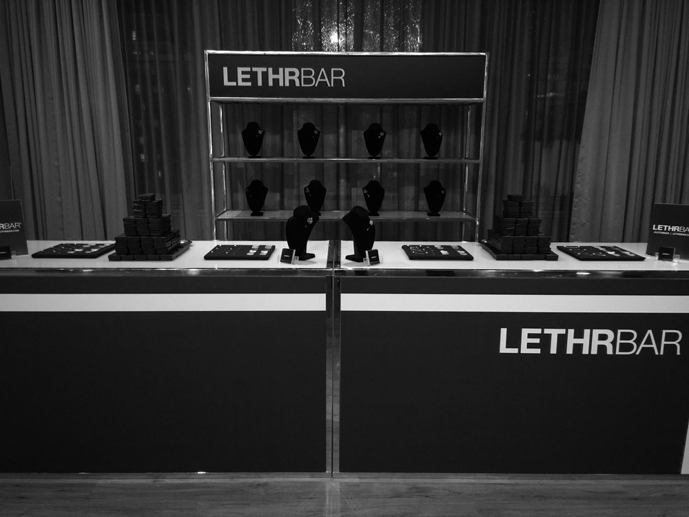 - At LETHRBAR®, we believe we are part of the event's entertainment, and we help fulfil strategic objectives for our clients by engaging with their guests.  We design, manufacture, and hand-make every item in our Calgary studio using laser-cutting technology, eco-friendly leather dyes, and a local team of leather specialists.  Our service provides guests with a unique experience by placing their monogram or favourite word on a leather memento in front of their eyes at the event.Interested in LETHRBAR® Live? Please contact us