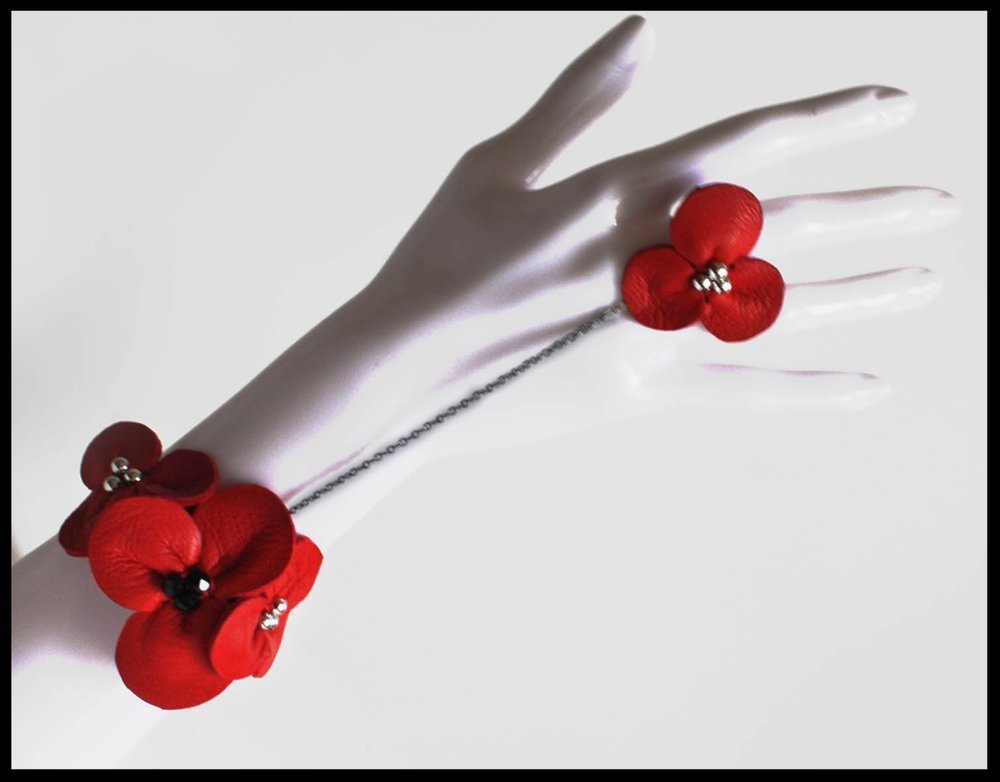 Leather corsage and matching chained floral ring