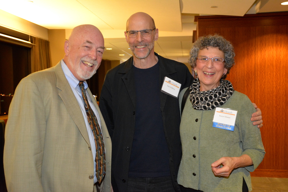 Hearth President & CEO Mark Hinderlie (left) with Board Member Karyn Scheier (right) and her husband Stan Dolberg (center).