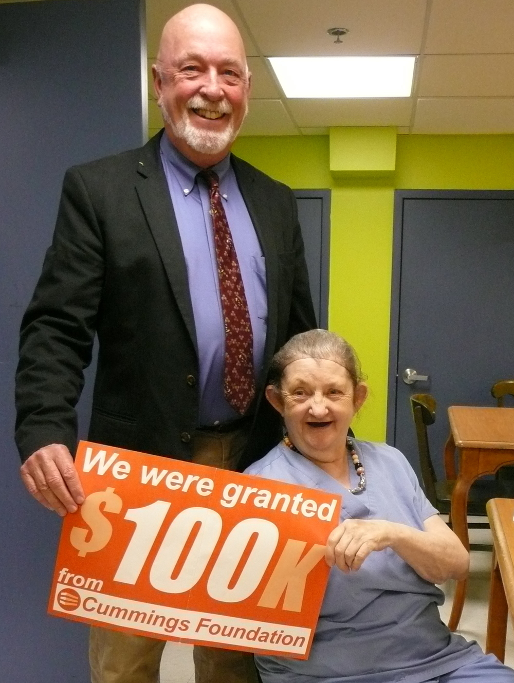 Hearth President & CEO Mark Hinderlie with resident - and volunteer - Freda Hardy.