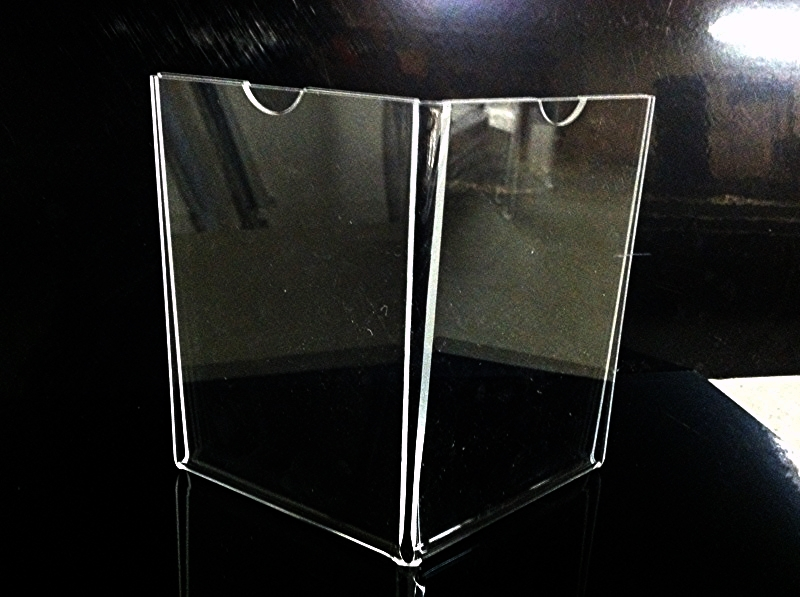 "This is an 1/8"" thick clear acrylic 2-way picture frame. They hold 4 x 6 size pictures. These are $6 each plus tax."