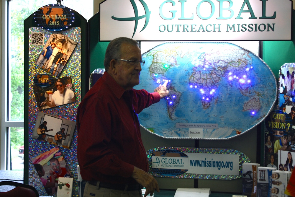 A missionary uses his display to show the places where his ministry is involved during NGU's global missions week September 8-10.