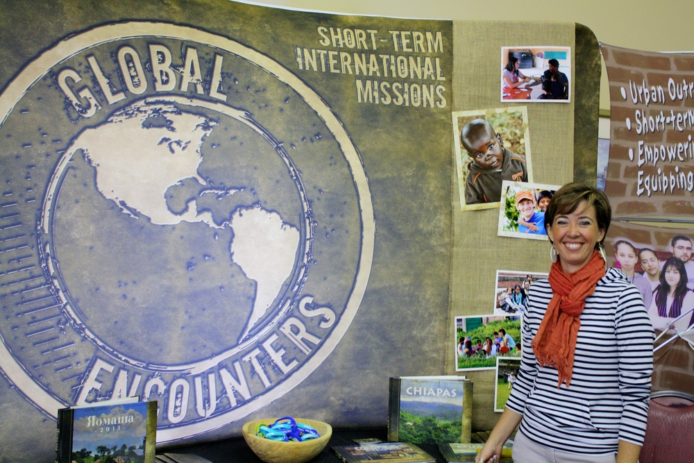 A missionary proudly stands next to her display during NGU's global missions week September 8-10.
