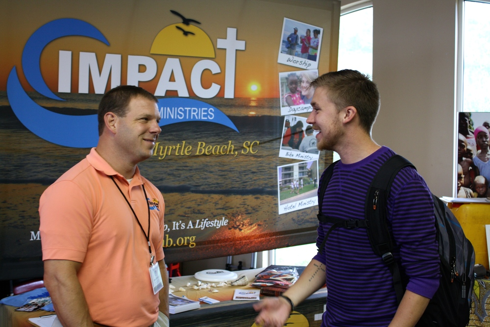 A student and a missionary share stories during NGU's global missions week September 8-10.