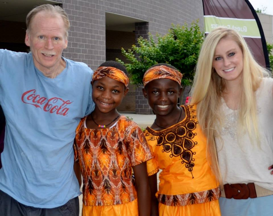 Photo courtesy of Katie Jones  Katie Jones and her father, Ken, stand with two of the young girls they ministered to while on the mission field.