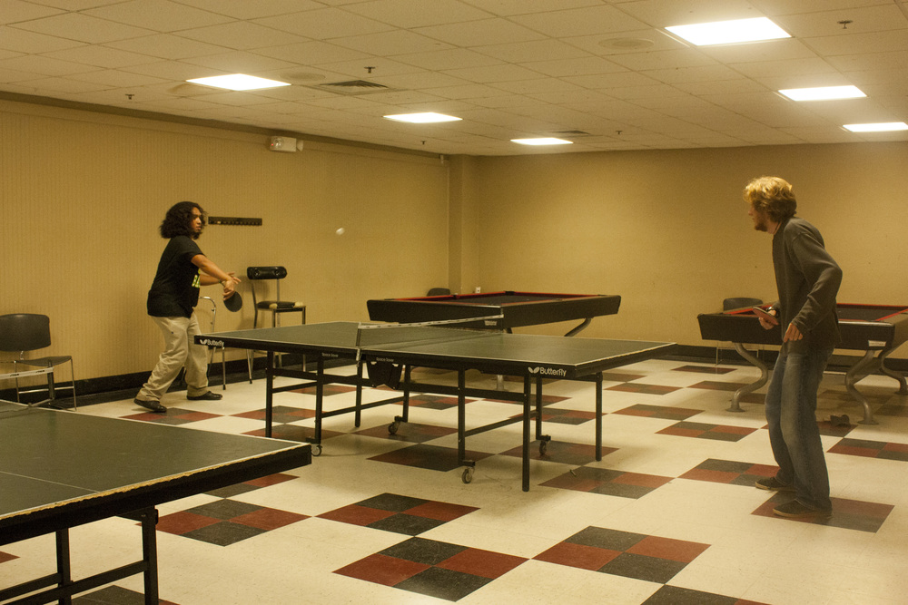 David Balles, sophomore, and Samuel Helms, sophomore, battle it out in a game of ping pong.