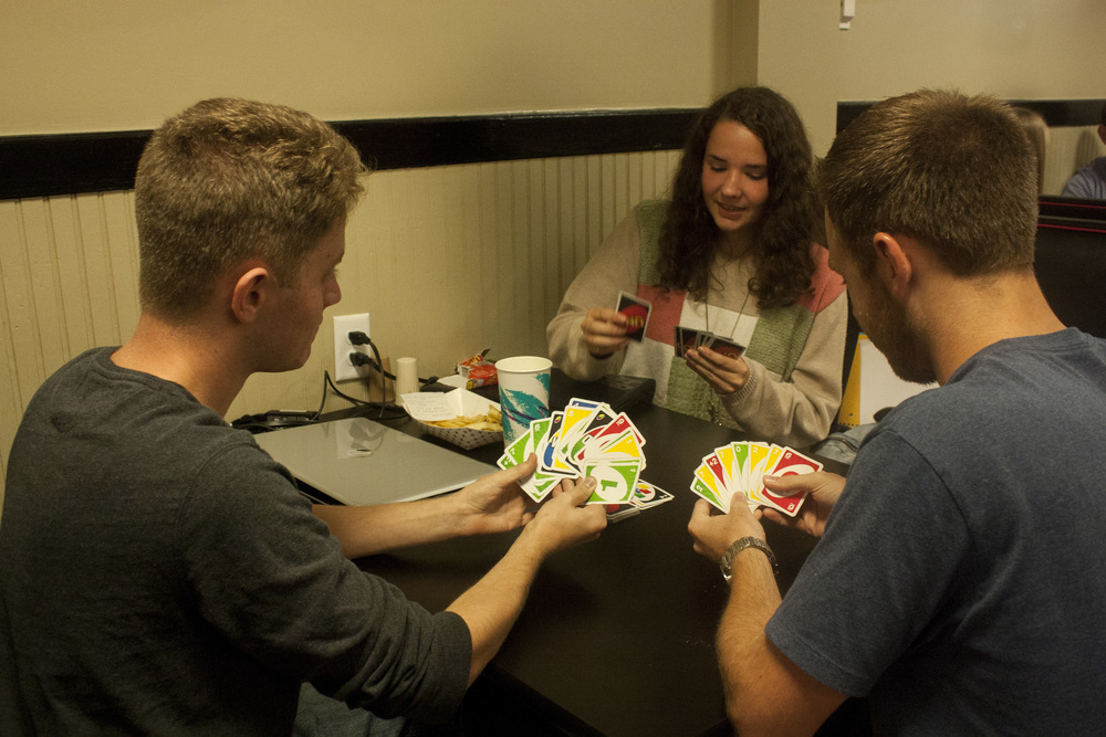 Wes Wessinger, junior, Bethany Stickley, sphomore, and Brandon Lee, junior, hang out in the stud playing a game of cards.