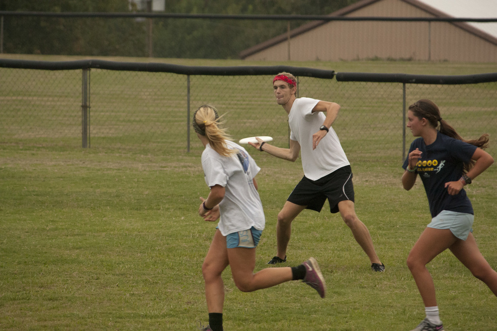 Tanner Furr, sophomore, intensely looks downfield to toss the Frisbee  to a fellow teammate on one of NGU's fields.
