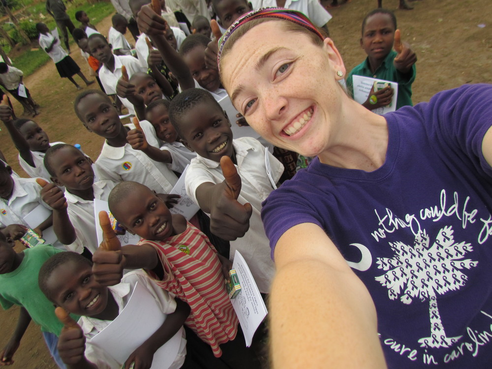 Courtney takes a selfie with her new Ugandan friends.