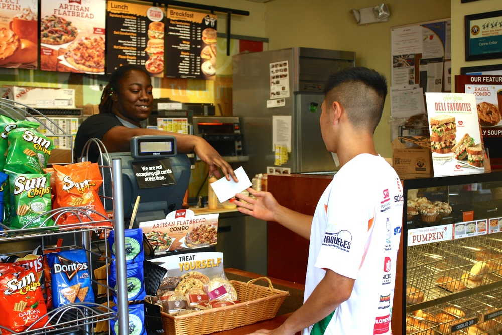 A student purchases a snack at Einsteins.