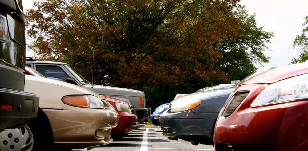 Student cars pile into the campus parking lot.