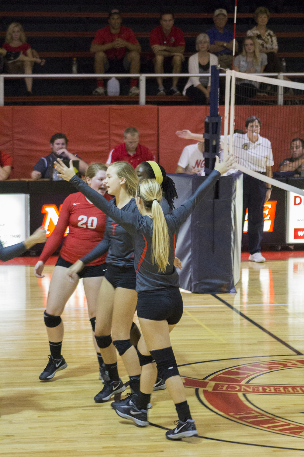 Junior Taylor Dupes, sophomore Haley Hester and junior Hannah Lewis celebrate after winning a point.