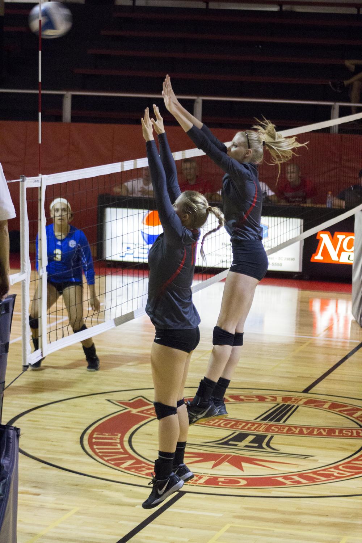 Sophomores Rachel Burts and Hannah Helbert attempt to block a return.