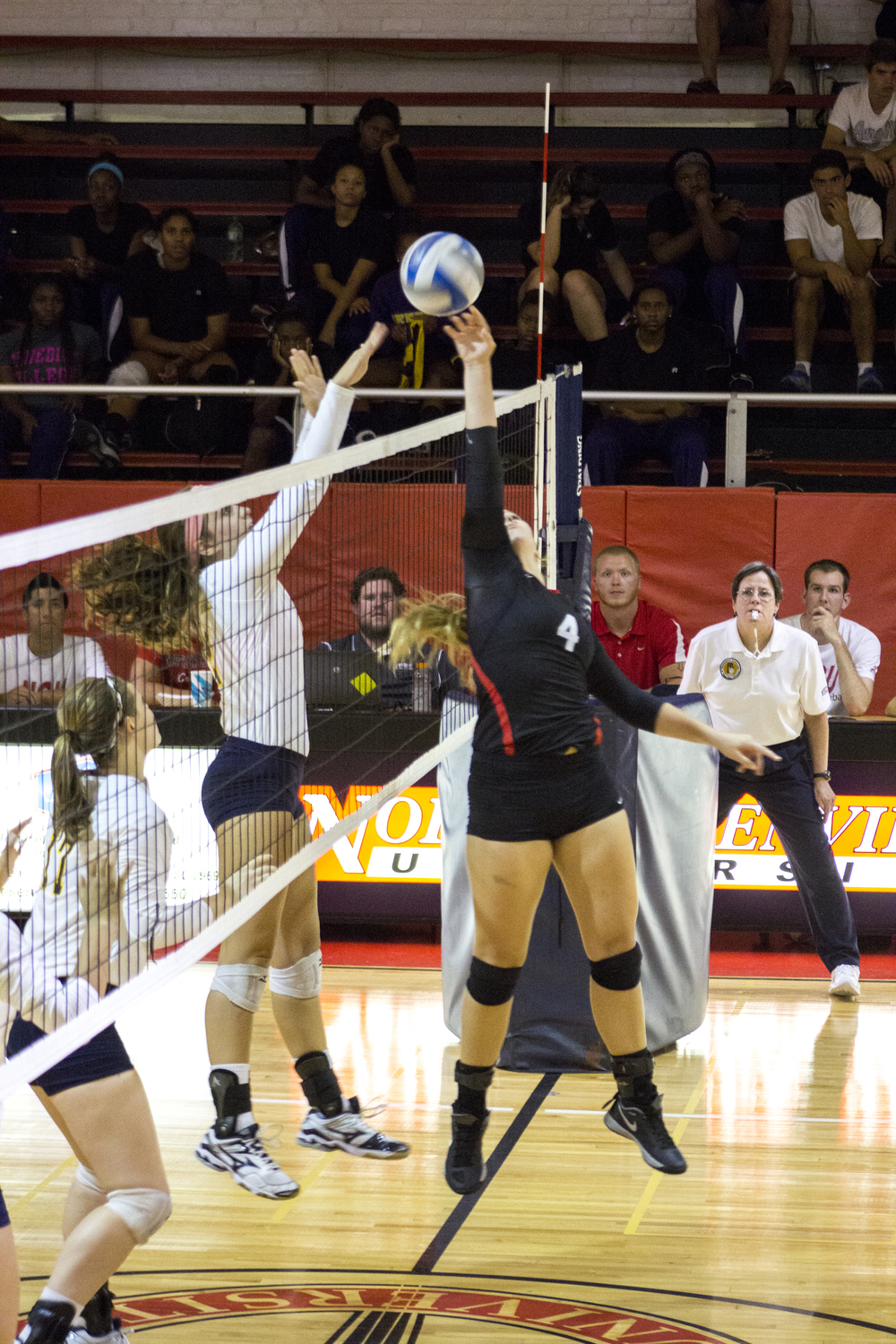 Sophomore Ashlyn Wilkinson tips the ball over to the opponent's side of the court.