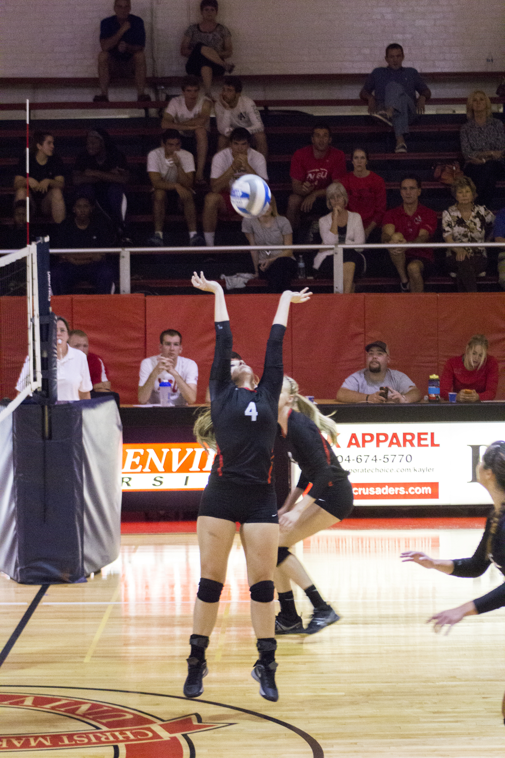 Sophomore Ashlyn Wilkinson sets the ball up for a perfect spike.