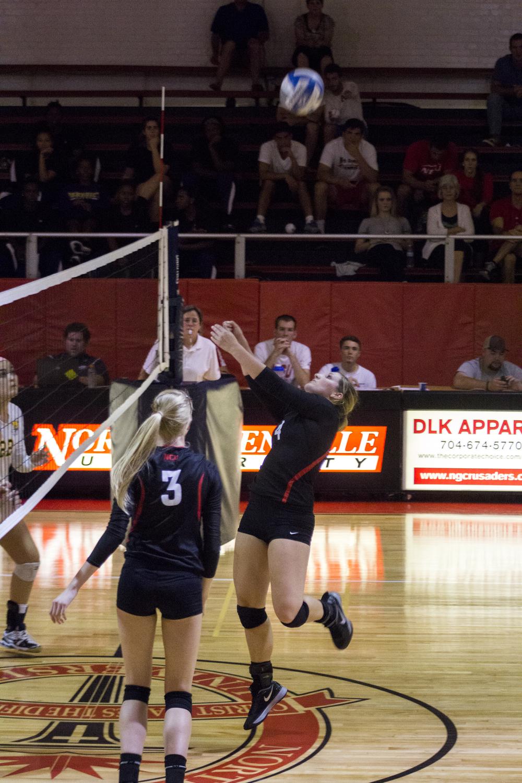 Sophomore Ashlyn Wilkinson bumps the ball backwards to her teammate.