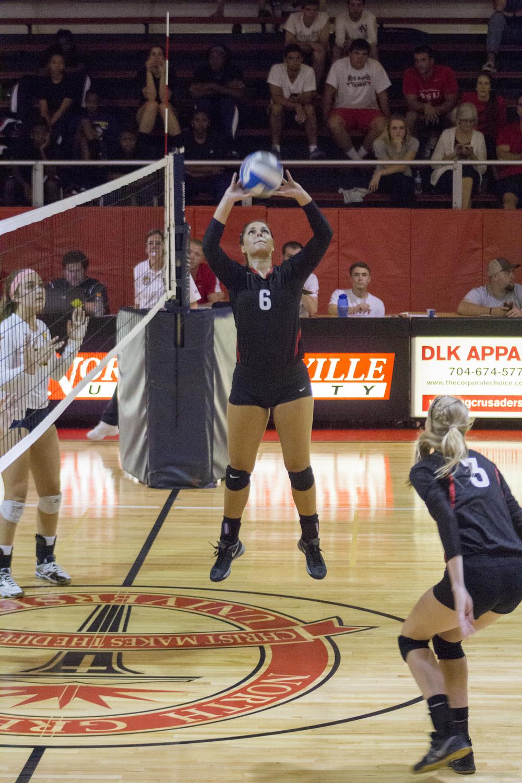 Senior Elizabeth James sets the ball up for sophomore Rachel Burts.
