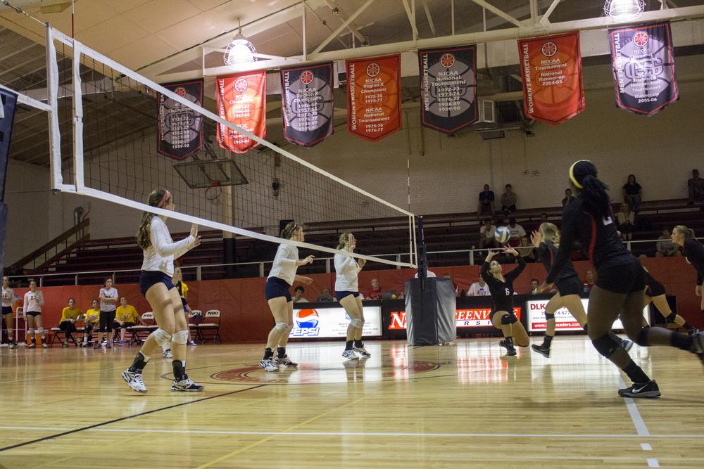 Senior Elizabeth James sets the ball up for a spike.
