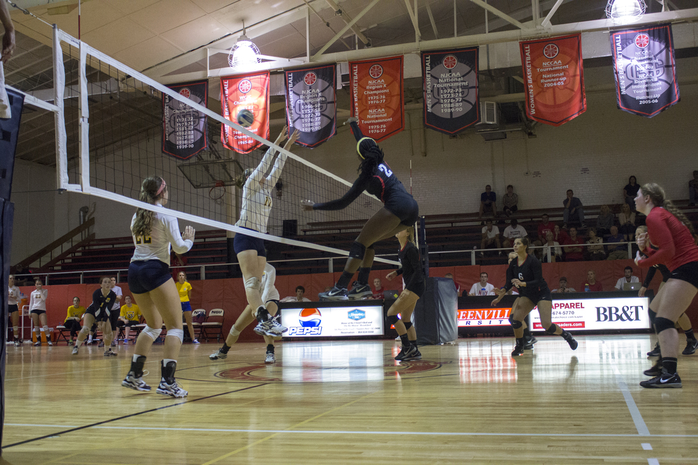 Junior Yomi Adeyeye stretches to spike the ball over the net.