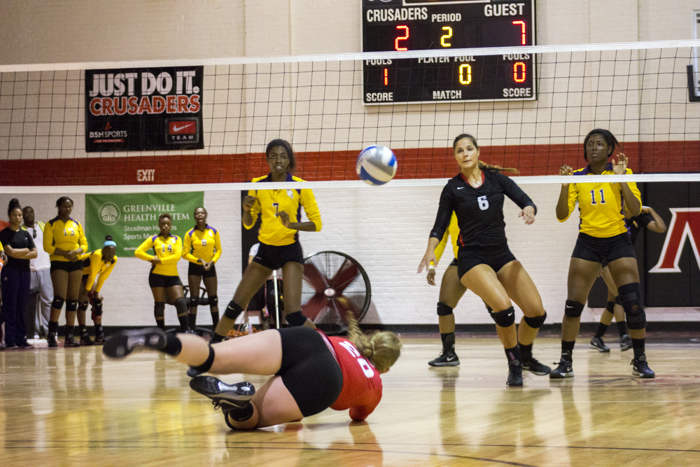 Junior Hannah Lewis dives to save the ball.