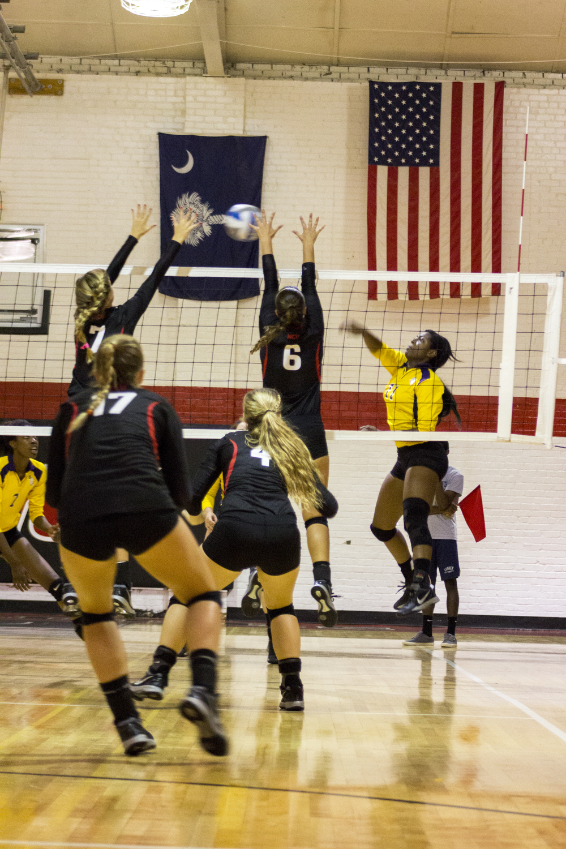 Senior Elizabeth James and sophomore Haley Hester jump up to block the oncoming spike.