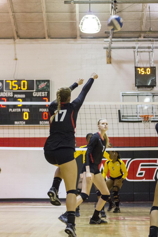 Sophomore Hannah Helbert sets the ball forward.