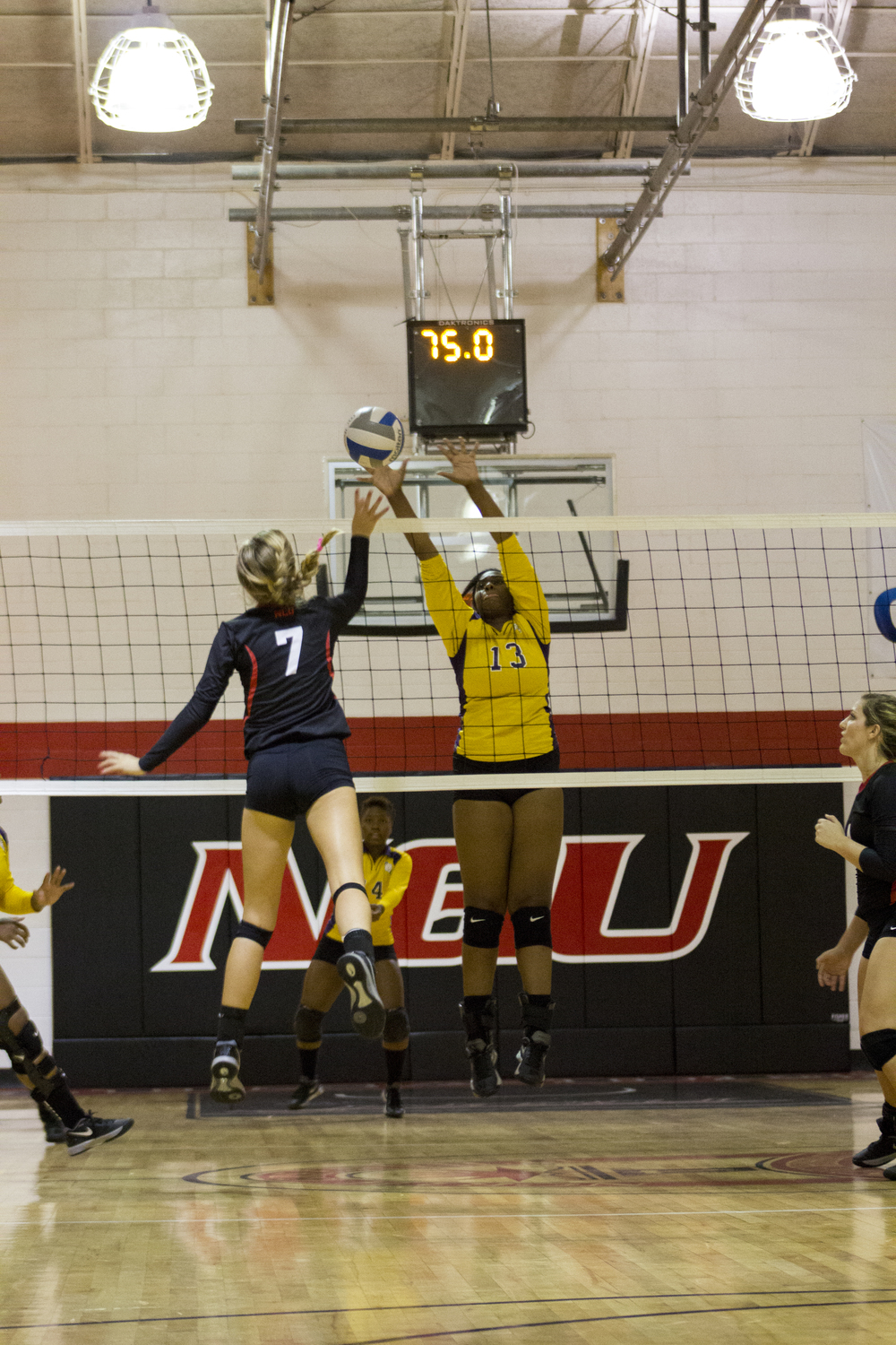 Sophomore Haley Hester dives forward to spike the ball.