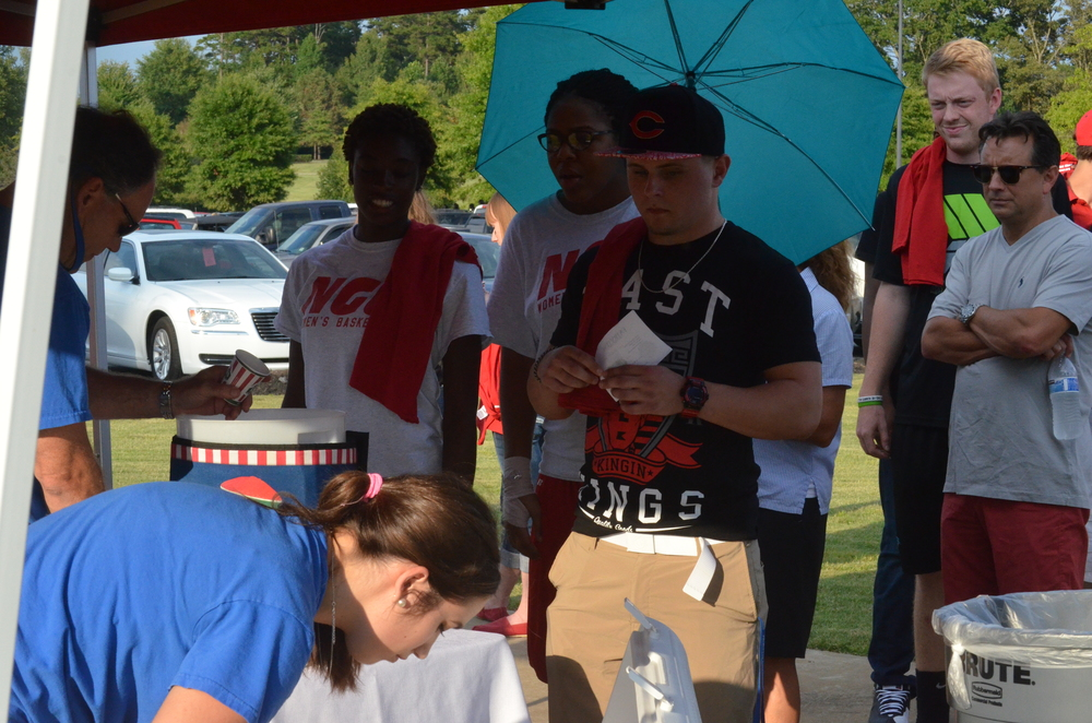 Students are in line to get free frozen treats from the local Italian Ice shop, RIta's.