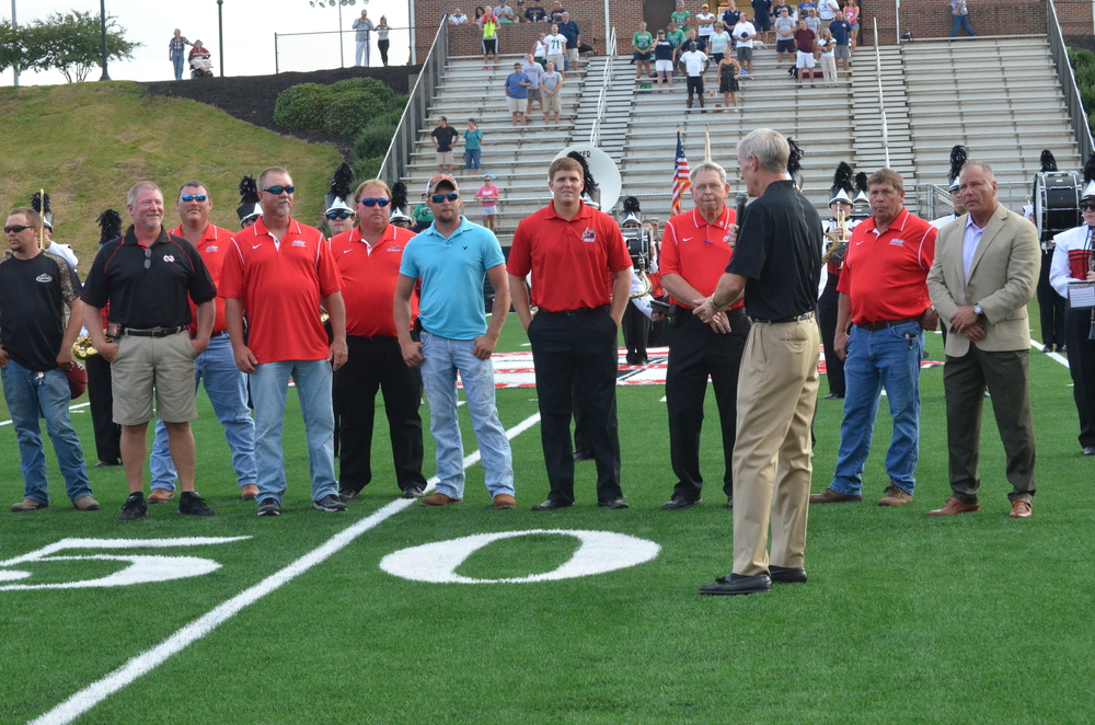 Epting is acknowledging the men who worked hard on putting in the new turf.