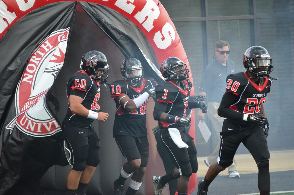 The team starts heading out of the tunnel to start the game