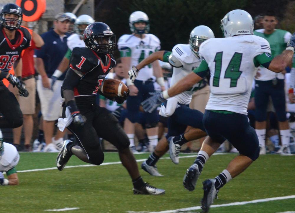Trey Walker sprints to get around the other team