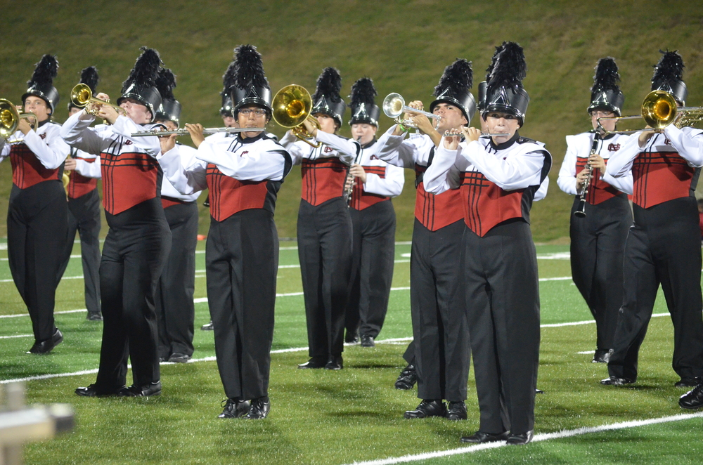 The band plays current hit songs during the half time show