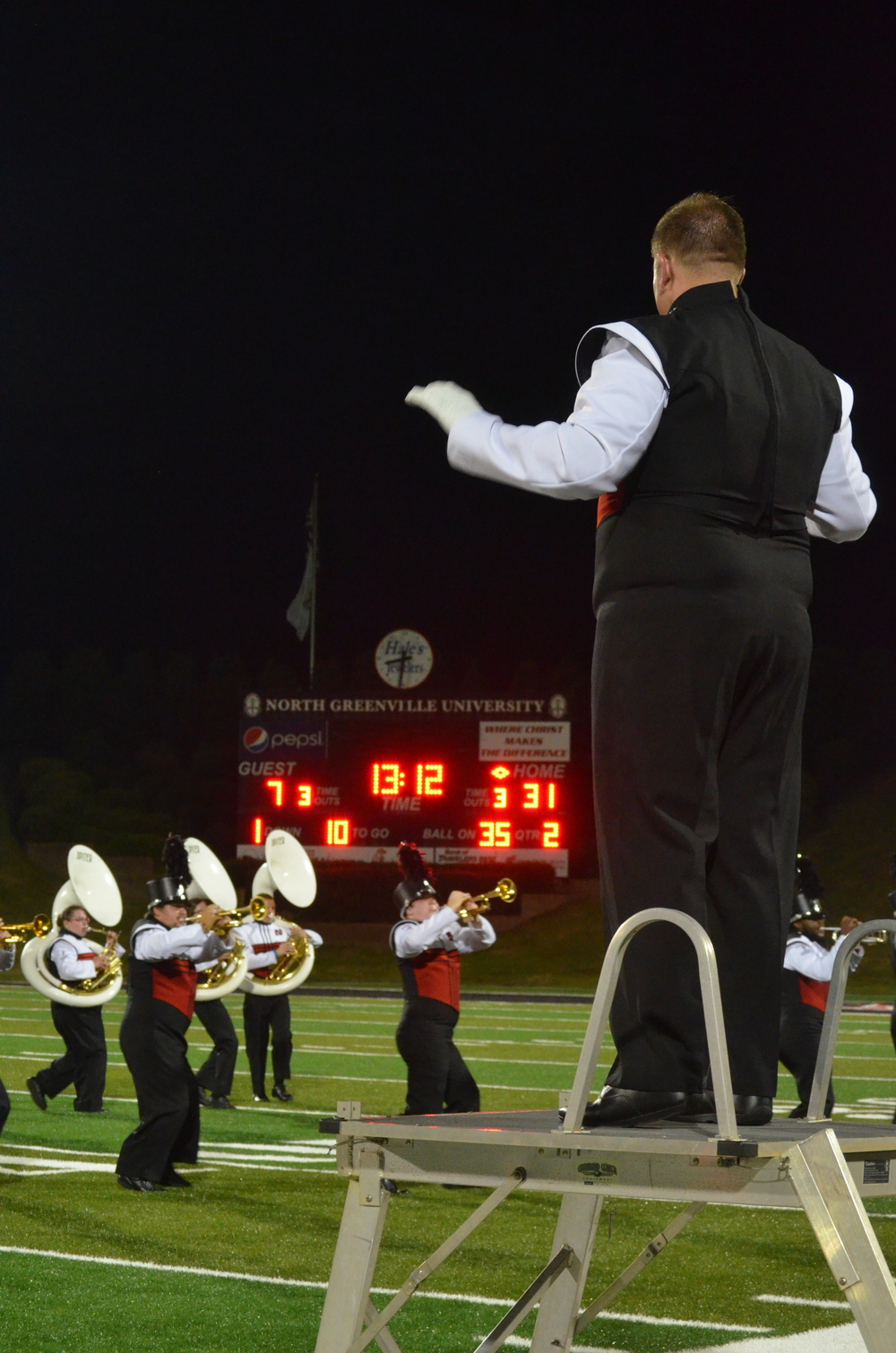 The Drum Major leads the band in playing