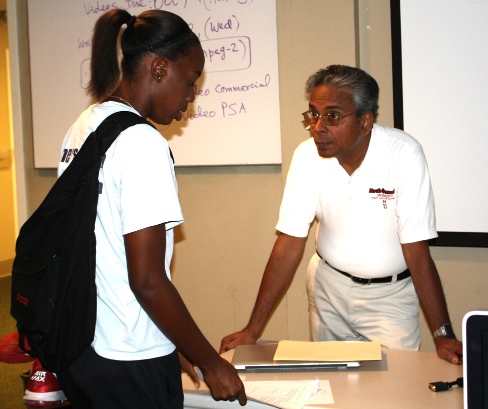 Shurajit Gopal talks with a student after one of his mass communication classes.